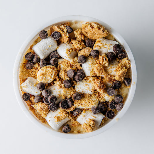 s'more please edible cookie dough shown with all toppings marshmallows, chocolate chips and graham crackers on top