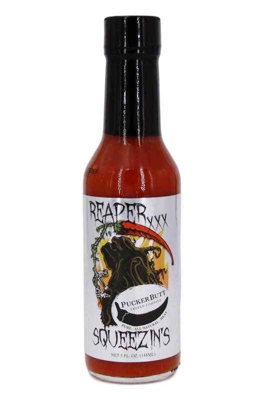 Puckerbutt Reaper squeezins hot sauce made with the Carolina reaper, worlds hottest pepper, Scoville sauce