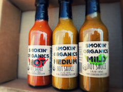 PuckerbuttPepper,Currie Organics Smokin Organic Hot Sauce gift pack. Smokin organics hot sauce, medium sauce and mild sauce in gift box