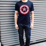 Cap'Native America Shield tee male standing outside of garage
