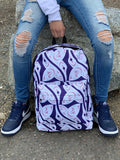 model holds hummingbird pattern backpack from top handle