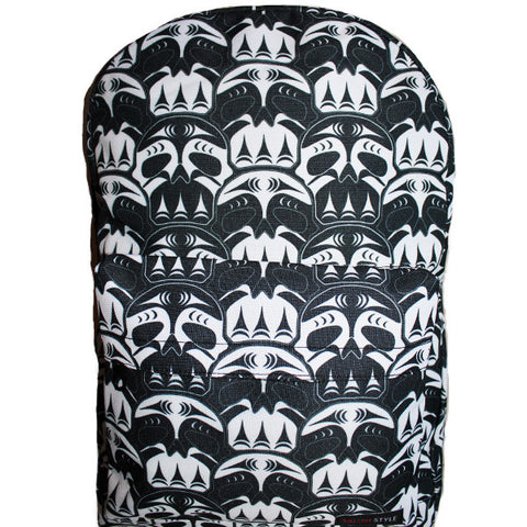 white and black backpack with skull pattern