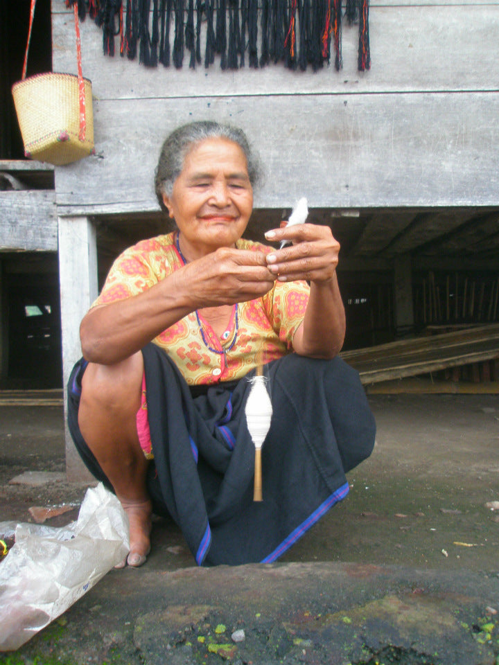 Flores Woman Sewing