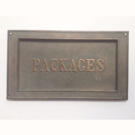 Cast Bronze Package Slot Mounts in Door