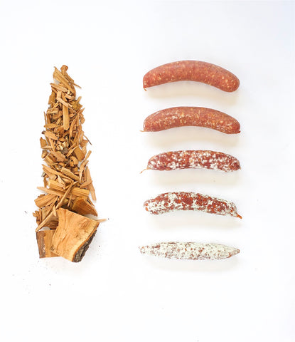 a photo of various states of mold on salami next to hard wood used for smoking sausages at Olympia Provisions