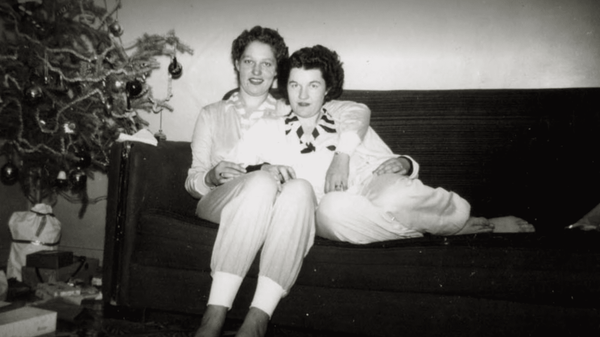 Photo of Pat and Terry cuddling on the couch together from lesbian Netflix documentary A Secret Love