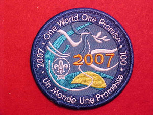 "2007 PATCH, SCOUTING CENTENNIAL, ENGLISH/FRENCH ""ONE WORLD ONE PROMISE"" 75MM DIAMETER"