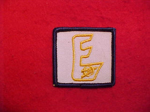 "EXPLORER ""E"" JACKET EMBLEM ON WHITE TWILL,1960S"