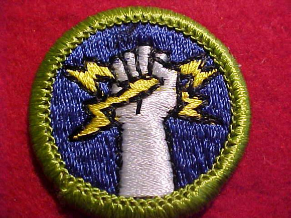 ELECTRICITY, MERIT BADGE WITH CLEAR PLASTIC BACK, GREEN BORDER, NO IMPRINTS/LOGOS IN PLASTIC, 1972-2002