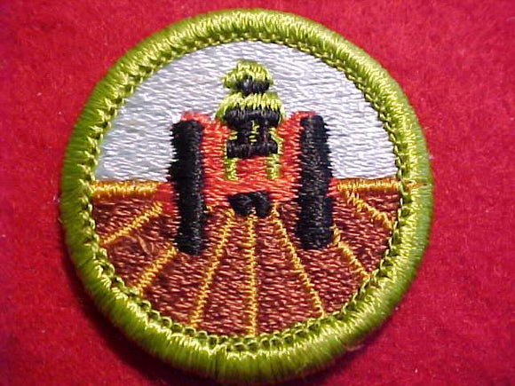 FARM MECHANICS, MERIT BADGE WITH CLEAR PLASTIC BACK, GREEN BORDER, NO IMPRINTS/LOGOS IN PLASTIC, NO ROLL BAR ON TRACTOR, 1972-99