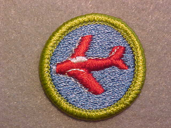 AVIATION, MERIT BADGE WITH CLEAR PLASTIC BACK, GREEN BORDER, NO IMPRINTS/LOGOS IN PLASTIC
