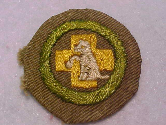 FIRST AID TO ANIMALS MERIT BADGE, WIDE BORDER CRIMPED, 1934-35, USED