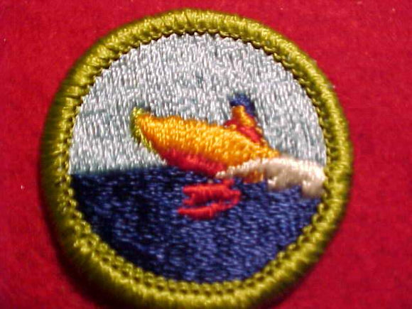 MOTORBOATING, MERIT BADGE WITH CLEAR PLASTIC BACK, GREEN BORDER, NO IMPRINTS/LOGOS IN PLASTIC, 1972-2002