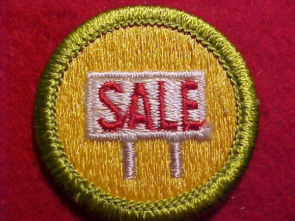 SALESMANSHIP, MERIT BADGE WITH CLEAR PLASTIC BACK, GREEN BORDER, NO IMPRINTS/LOGOS IN PLASTIC, 1972-2002