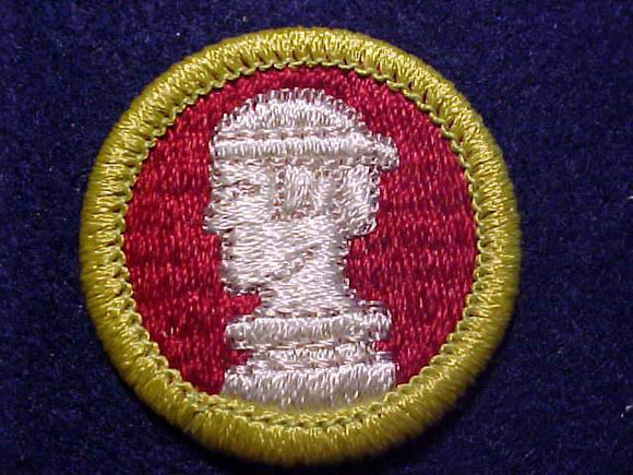 SCULPTURE, MERIT BADGE WITH CLEAR PLASTIC BACK, GREEN BORDER, NO IMPRINTS/LOGOS IN PLASTIC, 1972-2002