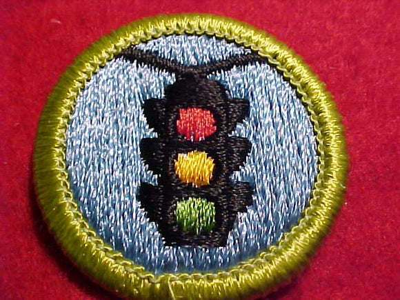 TRAFFIC SAFETY, MERIT BADGE WITH CLEAR PLASTIC BACK, GREEN BORDER, NO IMPRINTS/LOGOS IN PLASTIC, 1975-2002