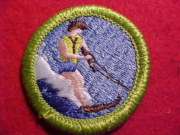 WATER SKIING, MERIT BADGE WITH CLEAR PLASTIC BACK, GREEN BORDER, NO IMPRINTS/LOGOS IN PLASTIC, 2003-2004, BROWN DETAILS ON LIFE JACKET