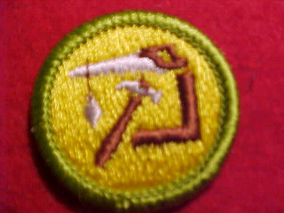 WOODWORK, MERIT BADGE WITH CLEAR PLASTIC BACK, GREEN BORDER, NO IMPRINTS/LOGOS IN PLASTIC, 1972-2002