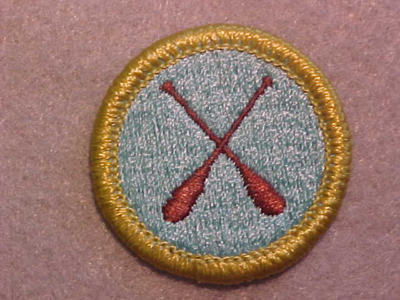CANOEING, MERIT BADGE WITH CLEAR PLASTIC BACK, GREEN BORDER, NO IMPRINTS/LOGOS IN PLASTIC