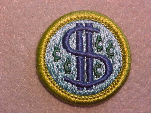 CONSUMER BUYING, MERIT BADGE WITH CLEAR PLASTIC BACK, GREEN BORDER, NO IMPRINTS/LOGOS IN PLASTIC