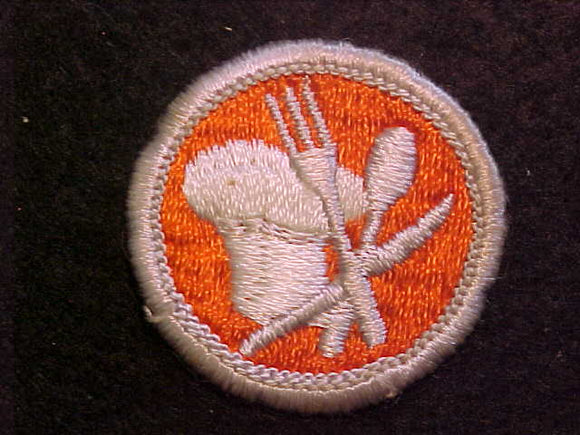 COOKING, MERIT BADGE WITH CLOTH BACK, SILVER BORDER, ISSUED 1969 TO 1972