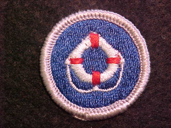 LIFESAVING 1969-72, MERIT BADGE WITH CLOTH BACK, SILVER BORDER, ISSUED 1969 TO 1972