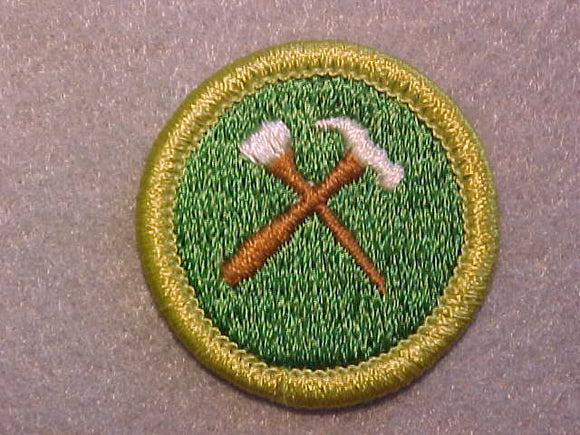 HOME REPAIRS, MERIT BADGE WITH CLEAR PLASTIC BACK, GREEN BORDER, NO IMPRINTS/LOGOS IN PLASTIC