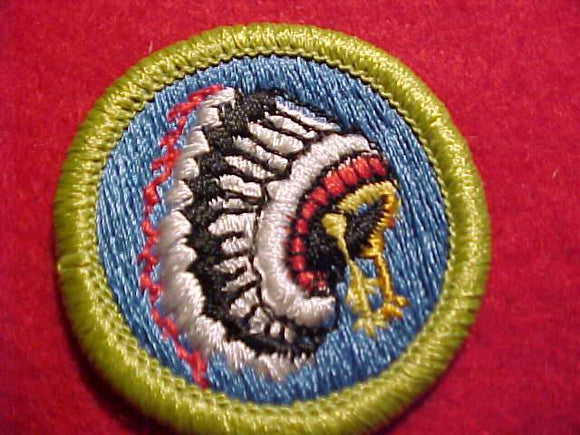 INDIAN LORE, MERIT BADGE WITH CLEAR PLASTIC BACK, GREEN BORDER, NO IMPRINTS/LOGOS IN PLASTIC, 1972-2002