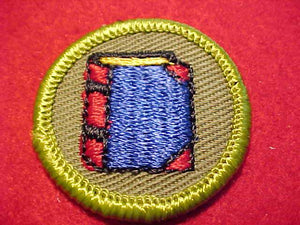 BOOKBINDING (NO BOOKMARK), ROLLED EDGE TWILL BKGR. MERIT BADGE
