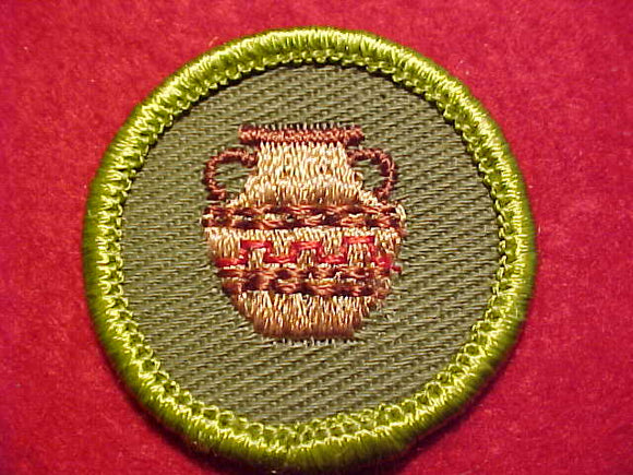 POTTERY, ROLLED EDGE TWILL BKGR. MERIT BADGE