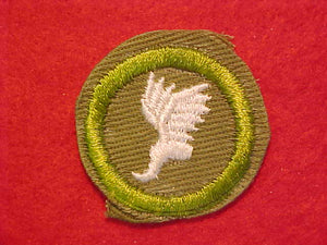 ATHLETICS, MERIT BADGE WITH CRIMPED EDGE, KHAKI, ISSUED 1946-60