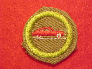 AUTOMOBILING, MERIT BADGE WITH CRIMPED EDGE, KHAKI, ISSUED 1946-60