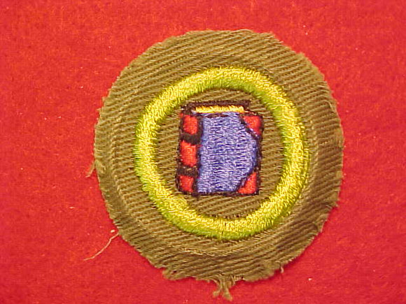 BOOKBINDING, MERIT BADGE WITH CRIMPED EDGE, KHAKI, ISSUED 1946-60
