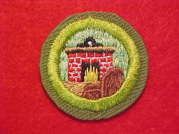 CITIZENSHIP IN THE HOME, MERIT BADGE WITH CRIMPED EDGE, KHAKI, ISSUED 1946-60