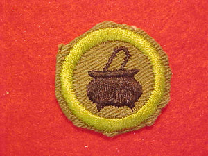 COOKING, MERIT BADGE WITH CRIMPED EDGE, KHAKI, ISSUED 1946-60