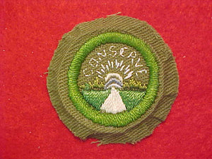 CONSERVATION, MERIT BADGE WITH CRIMPED EDGE, KHAKI, ISSUED 1946-60