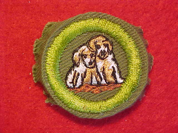 DOG CARE, MERIT BADGE WITH CRIMPED EDGE, KHAKI, ISSUED 1946-60