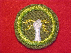 ELECTRICITY, MERIT BADGE WITH CRIMPED EDGE, KHAKI, ISSUED 1946-60