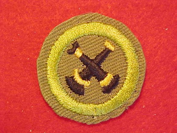 FIREMANSHIP, MERIT BADGE WITH CRIMPED EDGE, KHAKI, ISSUED 1946-60