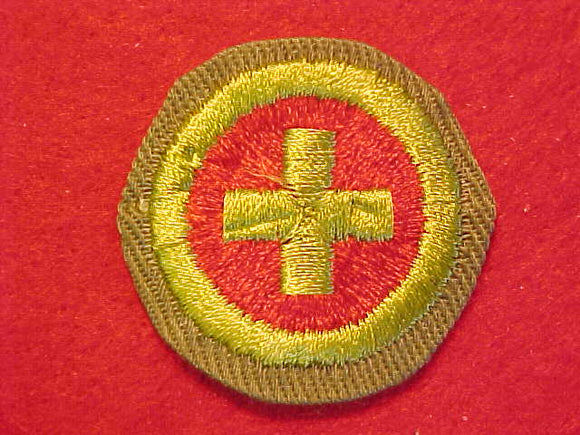 FIRST AID, MERIT BADGE WITH CRIMPED EDGE, KHAKI, ISSUED 1946-60