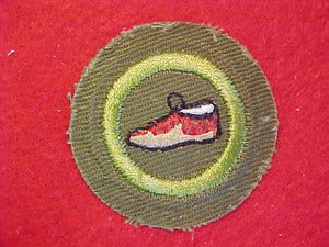 LEATHERCRAFT, MERIT BADGE WITH CRIMPED EDGE, KHAKI, ISSUED 1946-60