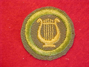 MUSIC, MERIT BADGE WITH CRIMPED EDGE, KHAKI, ISSUED 1946-60