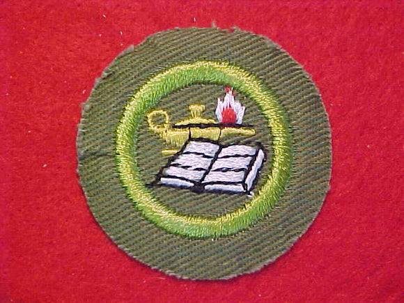 READING, MERIT BADGE WITH CRIMPED EDGE, KHAKI, ISSUED 1946-60