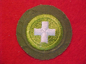 SAFETY, MERIT BADGE WITH CRIMPED EDGE, KHAKI, ISSUED 1946-60
