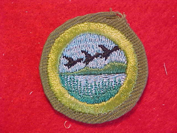 WILDLIFE MANAGEMENT, MERIT BADGE WITH CRIMPED EDGE, KHAKI, ISSUED 1946-60