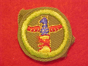 WOODCARVING, MERIT BADGE WITH CRIMPED EDGE, KHAKI, ISSUED 1946-60