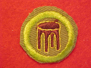 WOODWORK, MERIT BADGE WITH CRIMPED EDGE, KHAKI, ISSUED 1946-60