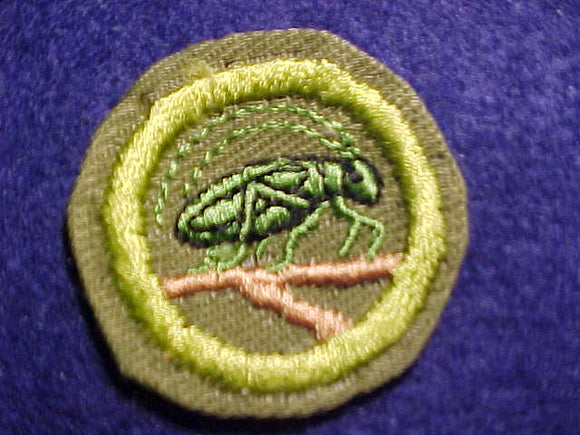 INSECT LIFE MERIT BADGE, CRIMPED EDGE, KHAKI, ISSUED 1946-1960