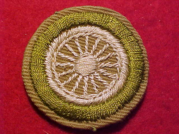 CYCLING MERIT BADGE, CRIMPED EDGE, TAN, ISSUED 1936-45