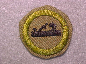 CARPENTRY, MERIT BADGE WITH CRIMPED EDGE, TAN, ISSUED 1936-45